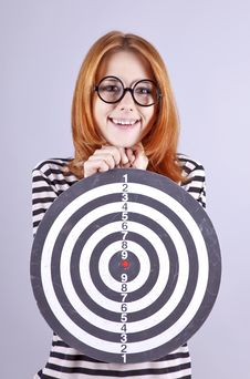 Red-haired Girl With Dartboard. Royalty Free Stock Photos