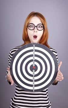 Red-haired Girl With Dartboard. Royalty Free Stock Image