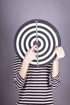 Girl With Dartboard In Place Of Head. Stock Photo