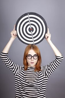 Red-haired Girl With Dartboard. Stock Images