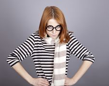 Free Angry Red-haired Girl In Glasses And Scarf. Stock Photography - 16639212