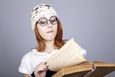 Free Funny Red-haired Girl With Old Book. Stock Photography - 16639282