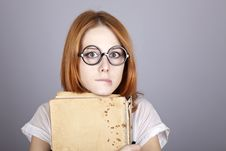 Free Funny Red-haired Girl With Old Book. Royalty Free Stock Photography - 16639347