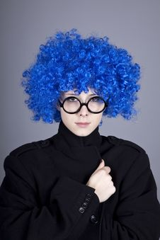 Funny Blue-hair Girl In Glasses And Black Coat. Stock Photos