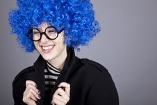 Funny Blue-hair Girl In Glasses And Black Coat. Stock Image