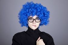 Funny Blue-hair Girl In Glasses And Black Coat. Royalty Free Stock Photos