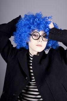 Funny Blue-hair Girl In Glasses And Black Coat. Stock Photography
