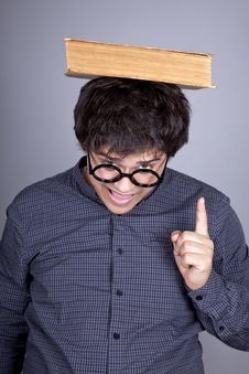 Young Men Thoughtful Men With Book Over Head. Stock Images