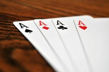 Four Aces - Playing Cards On Wooden Royalty Free Stock Photo