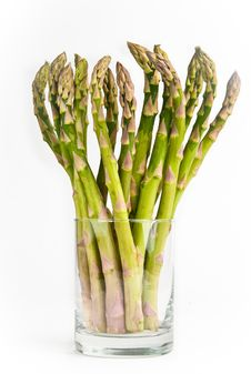 Free Bunch Of Fresh Green Asparagus Standing In A Glass Royalty Free Stock Photo - 16640905