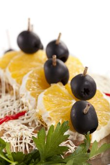 Dish Decorated With Oranges And Olives Stock Photo