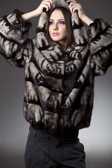 Woman In Fur Jacket With Hood Royalty Free Stock Photos