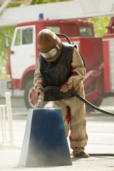 Free Worker In A Protective Suit Spraying Sand Stock Photos - 16646193