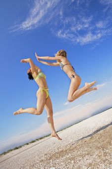 Free Girls Jumping On A Beach Royalty Free Stock Photos - 16646218