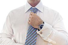 Free Handsome Young Businessman Adjusting Tie Stock Images - 16647054