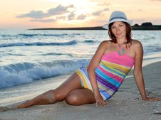 Woman In A Colorful Dress And Hat On The Beach Royalty Free Stock Photography