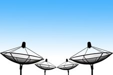 Satellite Dish Silhouettes And Blue Sky Background Stock Photo