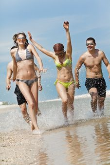 Free Friends Having Fun At The Beach Stock Photography - 16647792