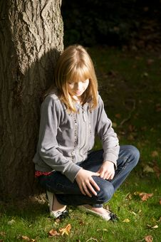 Free Young Girl Leaning On A Tree Stock Photo - 16650020