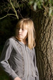 Free Young Girl Leaning On A Tree Royalty Free Stock Photo - 16650045