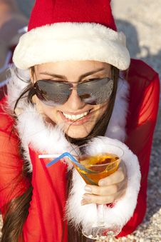 Woman In Christmas Suit With Martini On The Beach Royalty Free Stock Photos