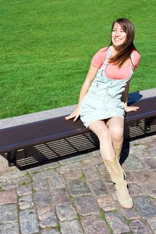Free Young Attractive Girl Model Sitting On Bench Royalty Free Stock Image - 16651736