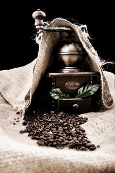 Vintage Coffee Grinder And Coffe Plant In Granules Stock Photography
