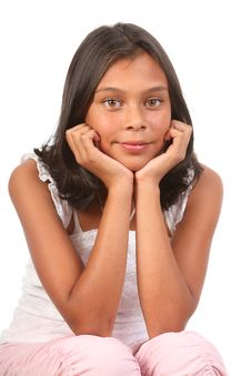 Free Teenage Girl Sitting Chin On Hands In Relaxed Pose Royalty Free Stock Images - 16652049