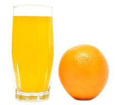 Fresh Orange And Orange Juice Royalty Free Stock Photography