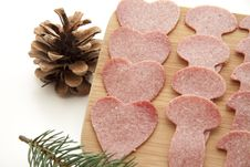 Sausage Plate With Pine Cone Stock Image