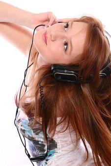 Beautiful Redhead With Headphones Stock Image