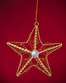 Christmas Tree Star Isolated On Red Royalty Free Stock Image
