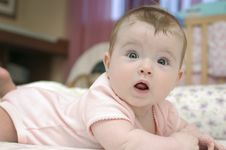 Free Adorable Baby Girl Looking At Camera Royalty Free Stock Images - 16659319