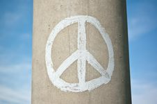 Peace Sign On A Concrete Pillar With Blue Sky Royalty Free Stock Photo