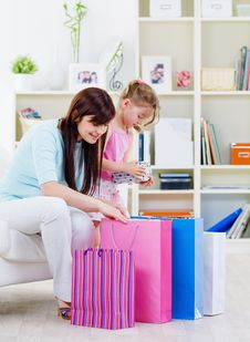 Mother And Daughter With Purchases At Home Royalty Free Stock Photos