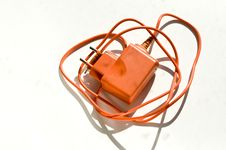 Free Orange Charger For A Mobile Phone Stock Image - 16665251