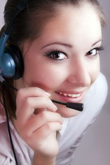 Free Portrait Of A Girl With A Headset Royalty Free Stock Image - 16666886