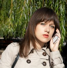 Free Beauty Woman With White Phone Royalty Free Stock Image - 16669846