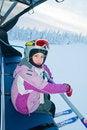 Free Little Girl-skier On The Ski Lift Royalty Free Stock Photo - 16679295