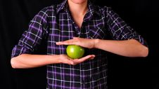 Woman Holding A Green Apple Royalty Free Stock Image