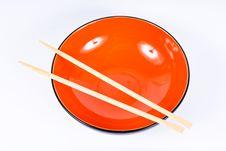 Orange Dish With Sticks Royalty Free Stock Photos