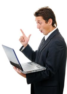 Young Businessman Reading Message On Laptop Stock Photography