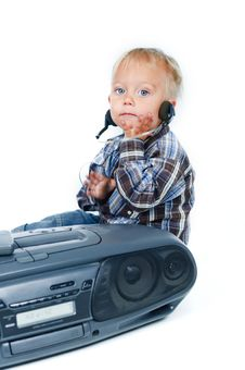 Free Little Cute Boy Listens To The Music Royalty Free Stock Image - 16679266
