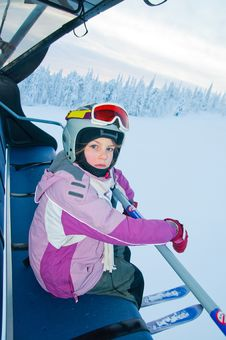 Free Little Girl-skier On The Ski Lift Royalty Free Stock Photo - 16679295