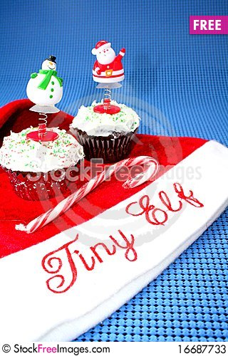 Free Santa Hat With Two Decorated Cupcakes Stock Photos - 16687733