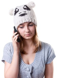 Beautiful Girl In Winter Hat With Telephone Royalty Free Stock Images