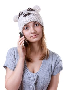 Beautiful Girl In Winter Hat With Telephone Stock Photo