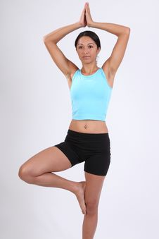 Free Beautiful Woman In Yoga Tree Pose During Exercise Stock Image - 16681871