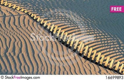 Free Fence And Shadows On Beach Stock Photos - 16699893