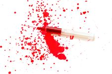 Free Syringe With A Red Liquid And Stains Stock Photography - 16692162